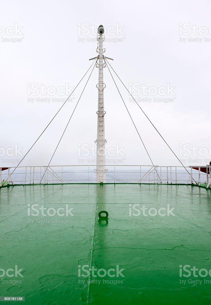 closeup White yacht mast against the white sky stock photo