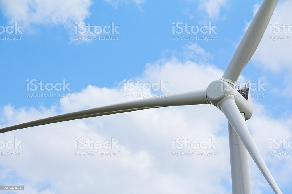 Closeup windturbine in front of a blue sky stock photo