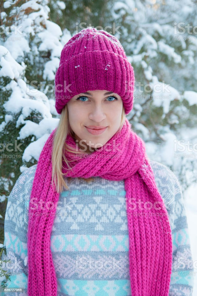 Closeup winter portrait of young girl in pink hat stock photo