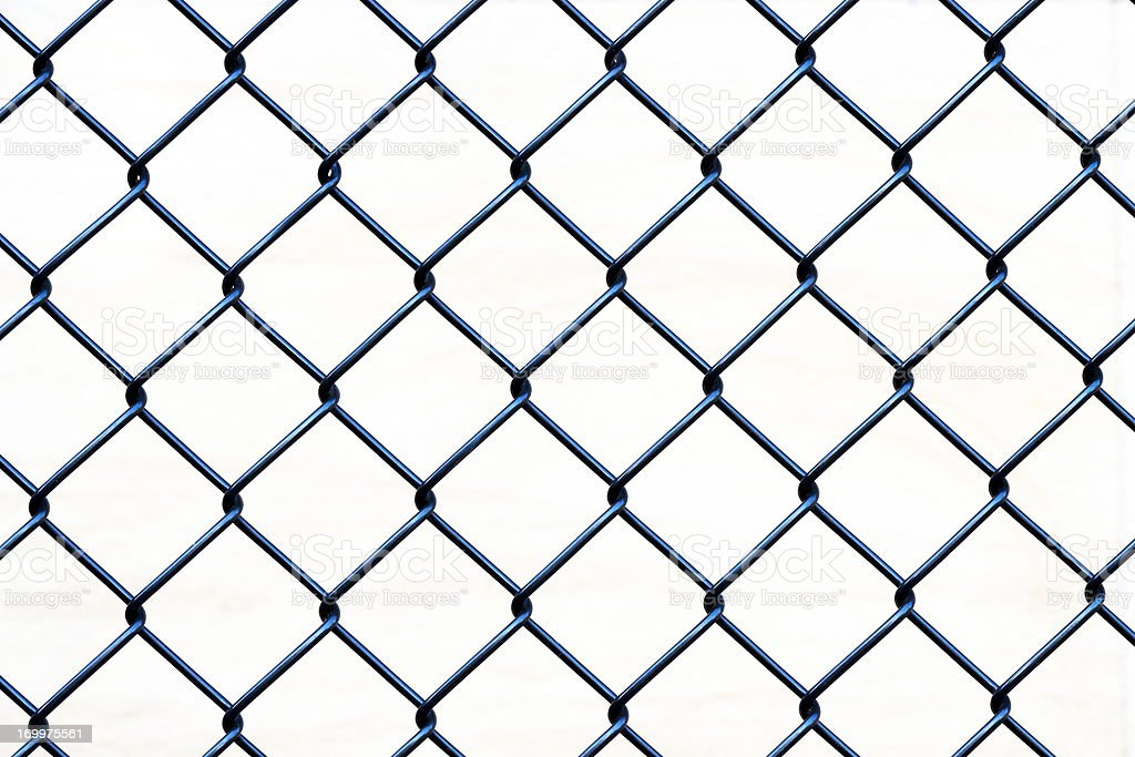 Closeup wire fence aginst white background, copy space stock photo