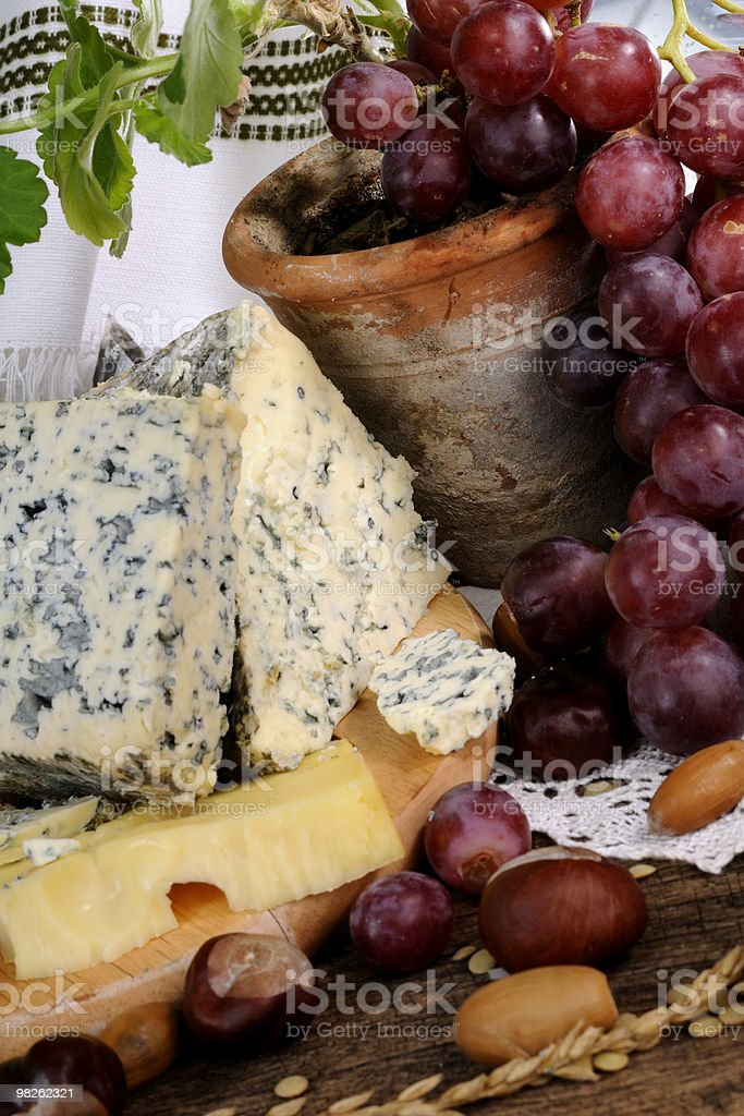 close-up with blue cheese and red grapes royalty-free stock photo