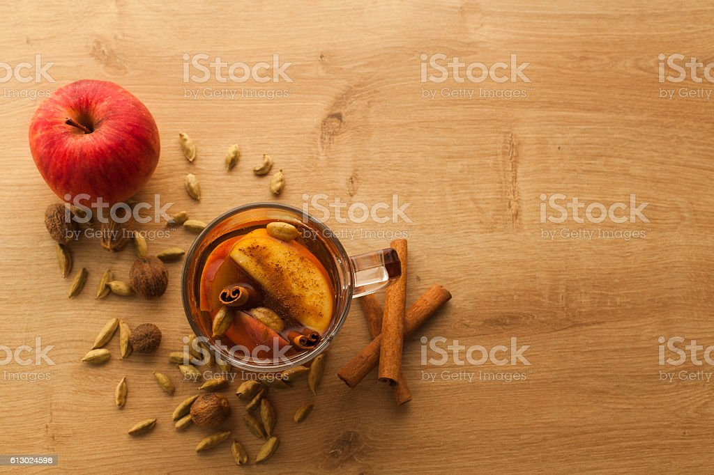 Closeup with free space of hot tea with apple and cinnamon. stock photo