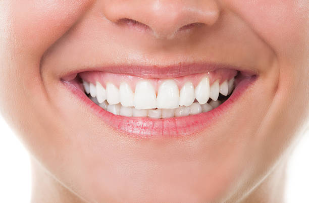 close-up with perfect smile - close to stock pictures, royalty-free photos & images