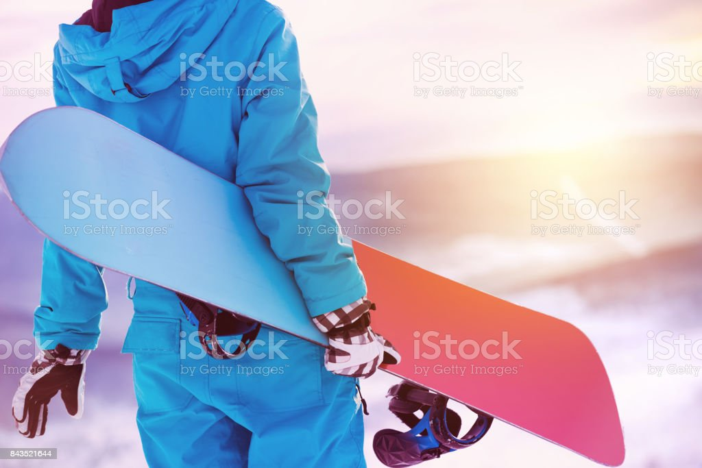 Closeup woman back snowboarder snowboard snowboarding stock photo