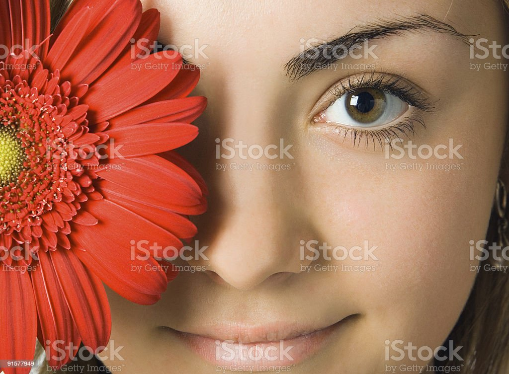 close-up woman eyes and  gerbera flower royalty-free stock photo