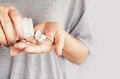 istock closeup woman hand holding medicine bottle taking overdose pills 1200883731