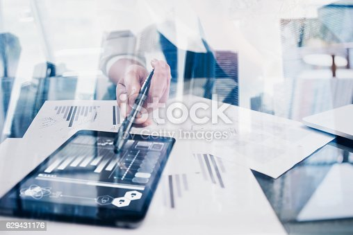 629421870 istock photo Closeup woman hand touching tablet display in coworking place.Concept 629431176