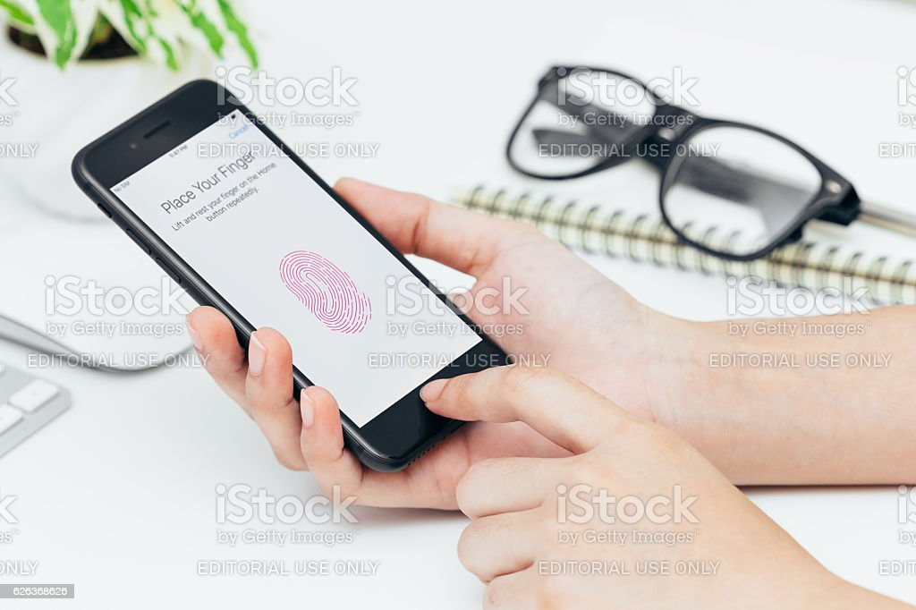 close-up woman hand using touch id on iphone 7, touch id is security...