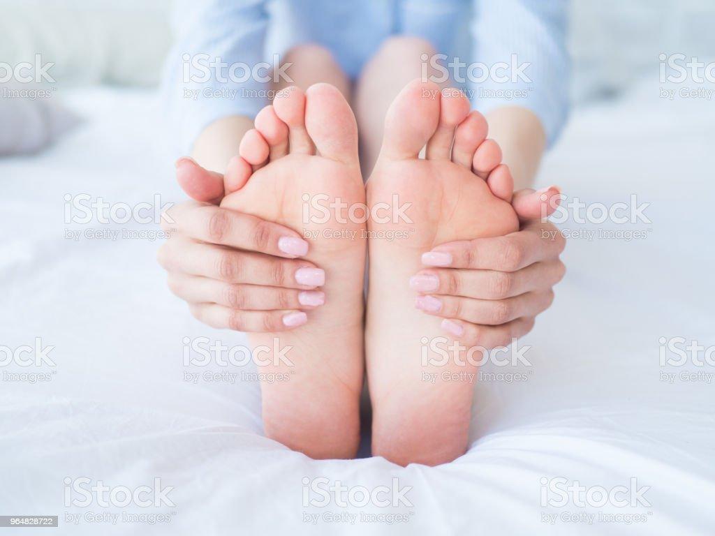 Closeup woman hands doing foot massage royalty-free stock photo