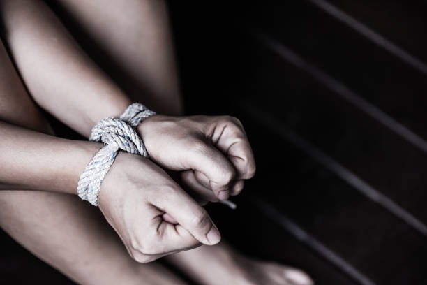 Closeup woman hands were tied with a rope. Violence, Terrified, Human Rights Day concept. Closeup woman hands were tied with a rope. Violence, Terrified, Human Rights Day concept. trafficking stock pictures, royalty-free photos & images