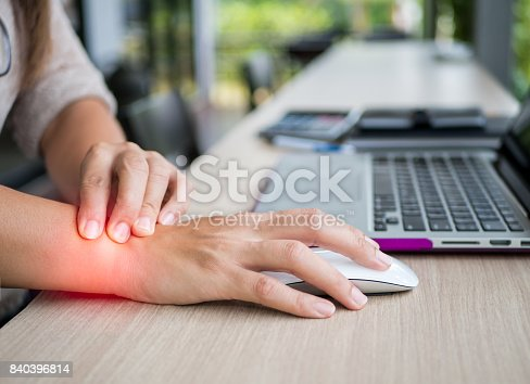 istock Closeup woman holding her wrist pain from using computer. Office syndrome hand pain by occupational disease. 840396814