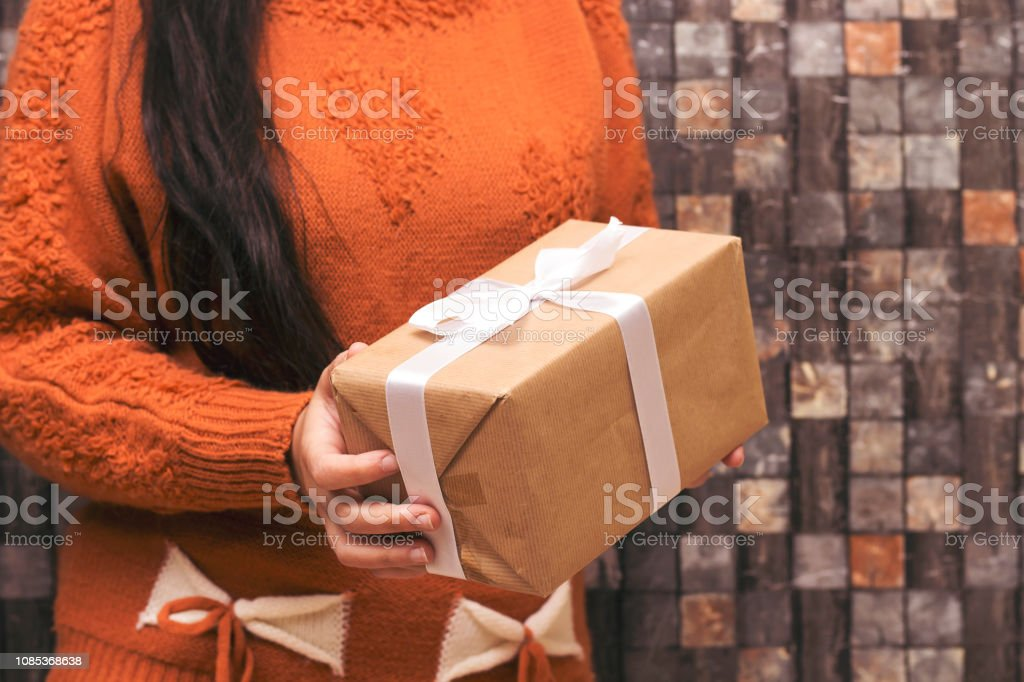 closeup woman holding present . Festive backdrop for holidays:...
