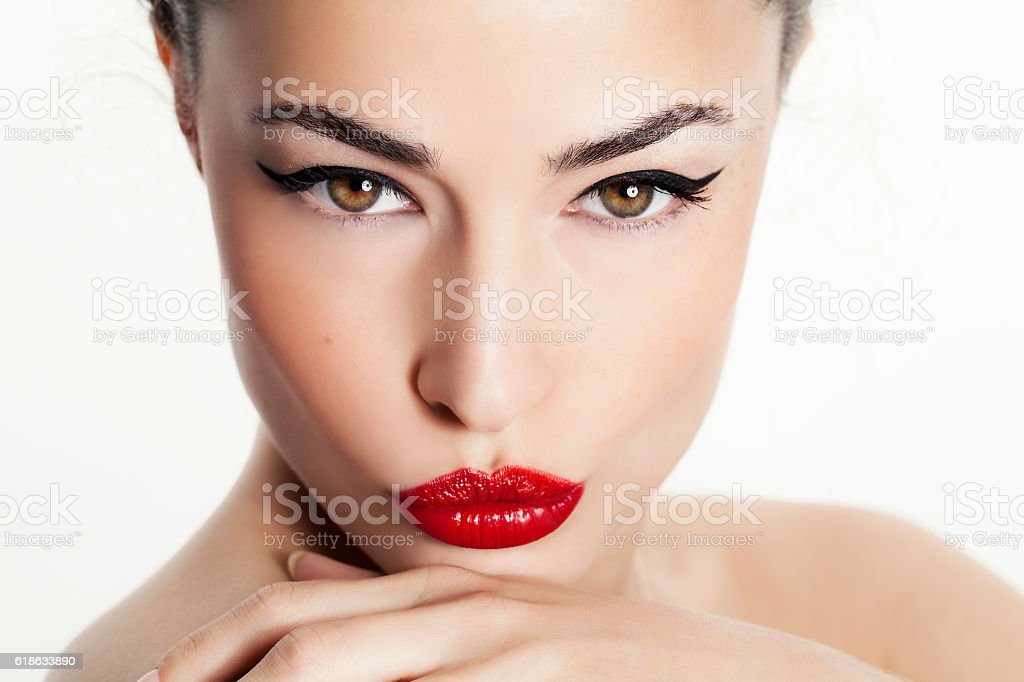closeup woman portrait with red lips and black eyeliner stock photo