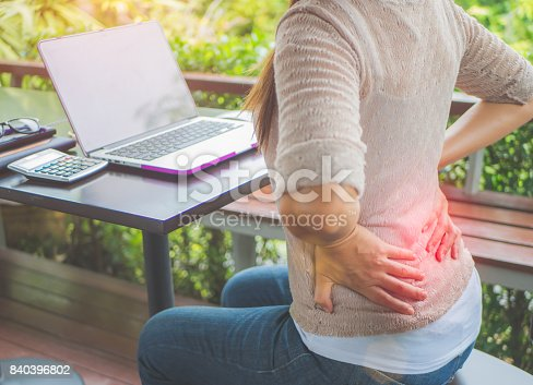 istock Closeup woman with hands holding her waist back in pain. Office syndrome and Health-care Concept. 840396802