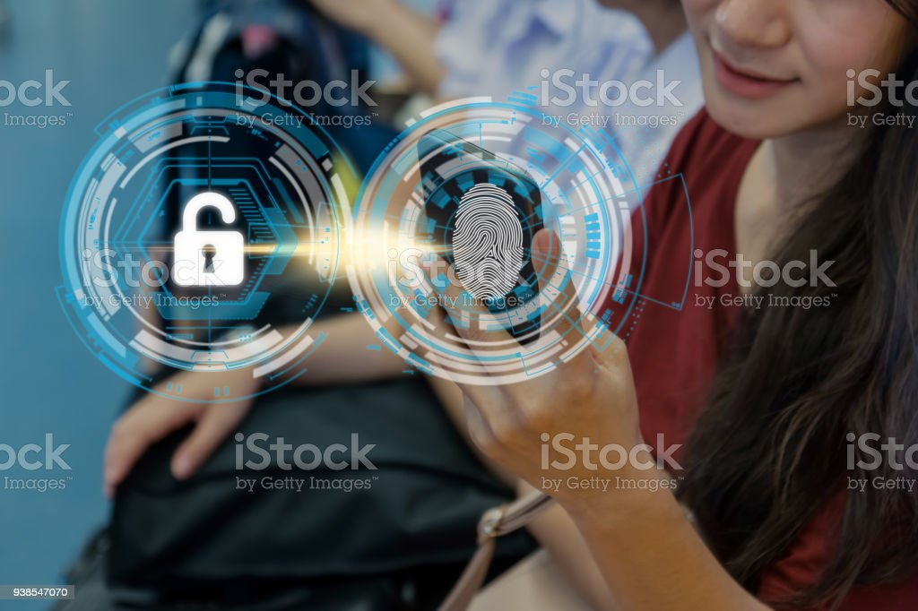Closeup Women Fingerprint scan for biometric authentication to unlock security in the BTS Skytrain rails or MRT subway, Business Technology sceurity Concept. stock photo