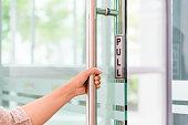 istock Closeup women hand open the door knob . 874231482