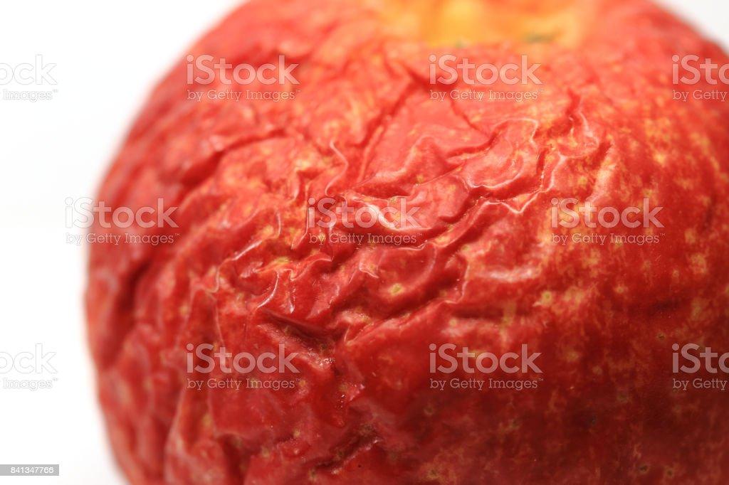 Close-up wrinkled apple stock photo