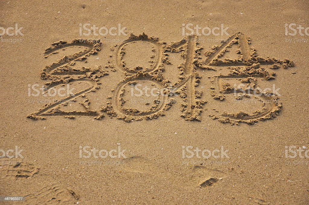 closeup Year 2014&2015 written by hand in the sand,Thailand royalty-free stock photo