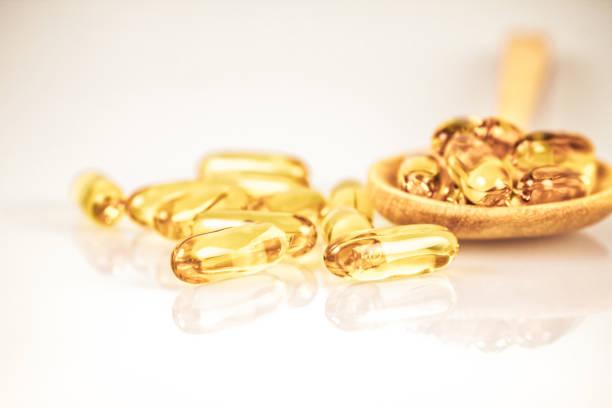 Gelbe weiche Gelbgelatine ergänzen Fischölkapsel – Foto