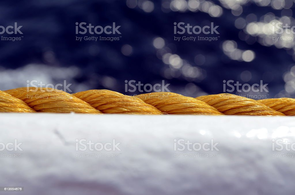 closeup yellow wrapped rope of a ship stock photo
