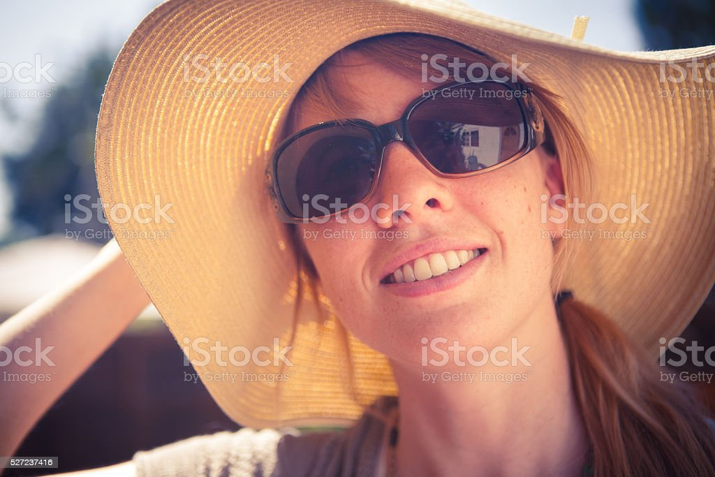 Close-up Young Adult Woman Floppy Hat Outside In Sunglasses stock photo