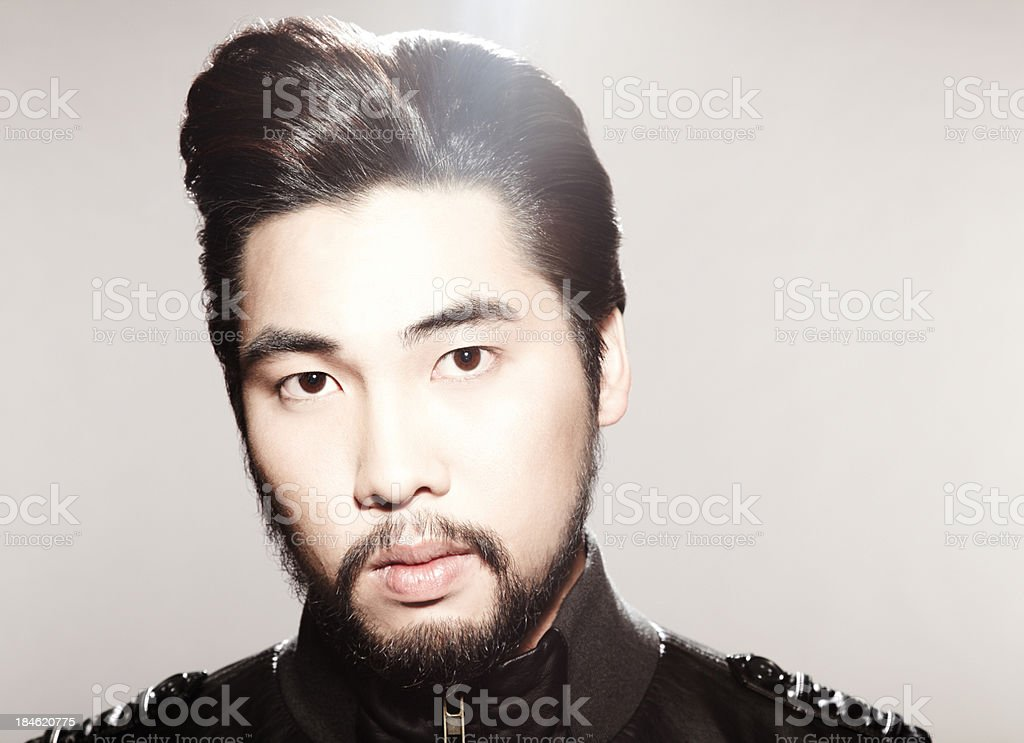 Closeup Young Asian man with funky hairstyle looking down stock photo