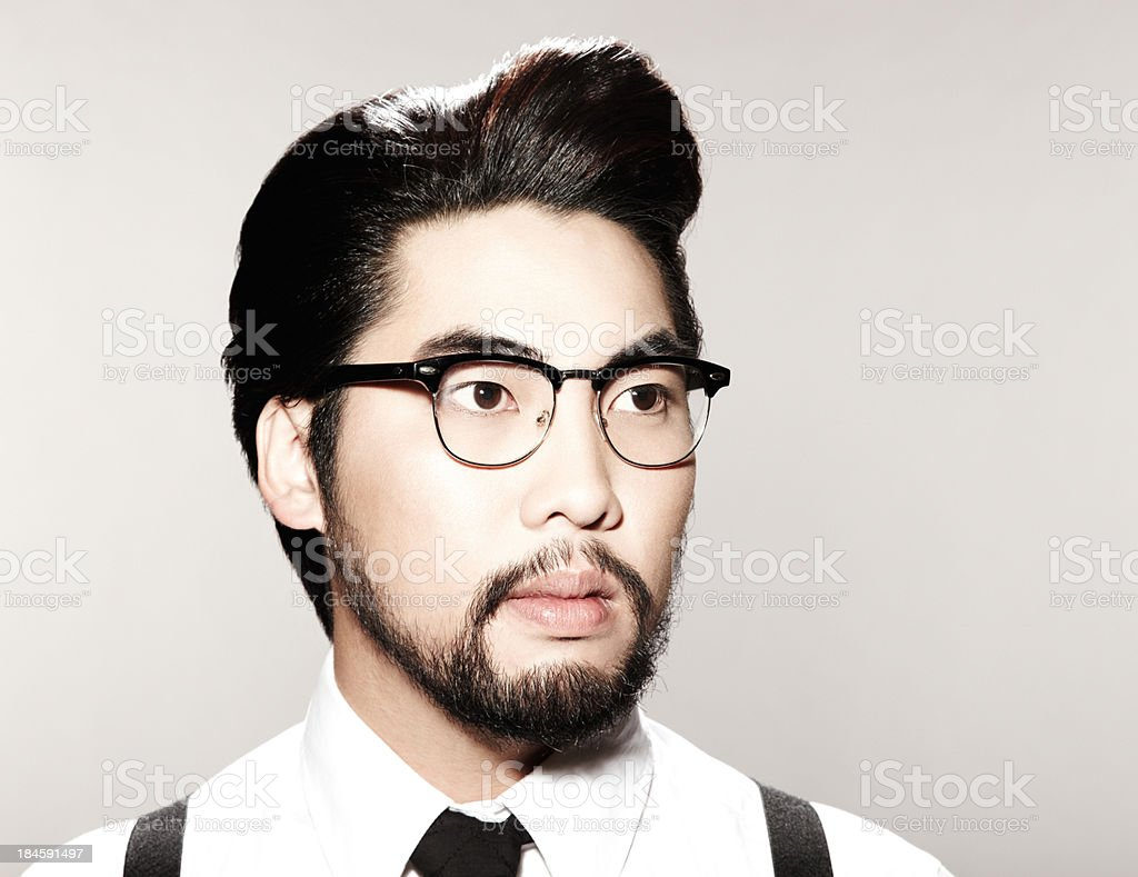 Closeup Young Asian man with funky hairstyle looking off royalty-free stock photo