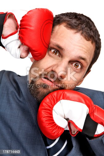521301688 istock photo Close-up young businessman struck by hands in boxing gloves 178714443