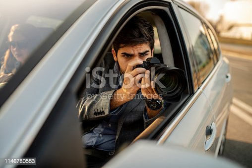 istock Close-up - Young Man Photorapher Sitting In The Car 1146780553