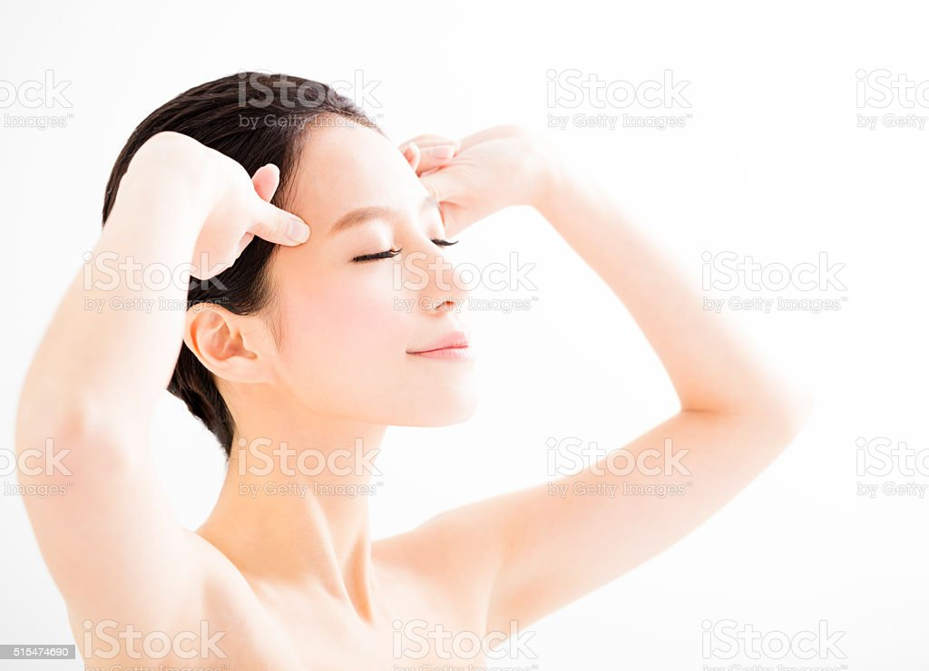 closeup young   woman face with massage gesture stock photo