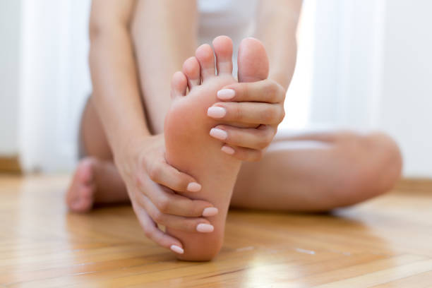 closeup young woman feeling pain in her foot - human foot stock photos and pictures