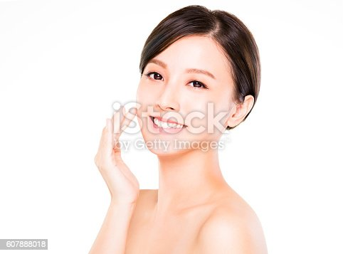 istock closeup   young  woman smiling face with clean  skin 607888018