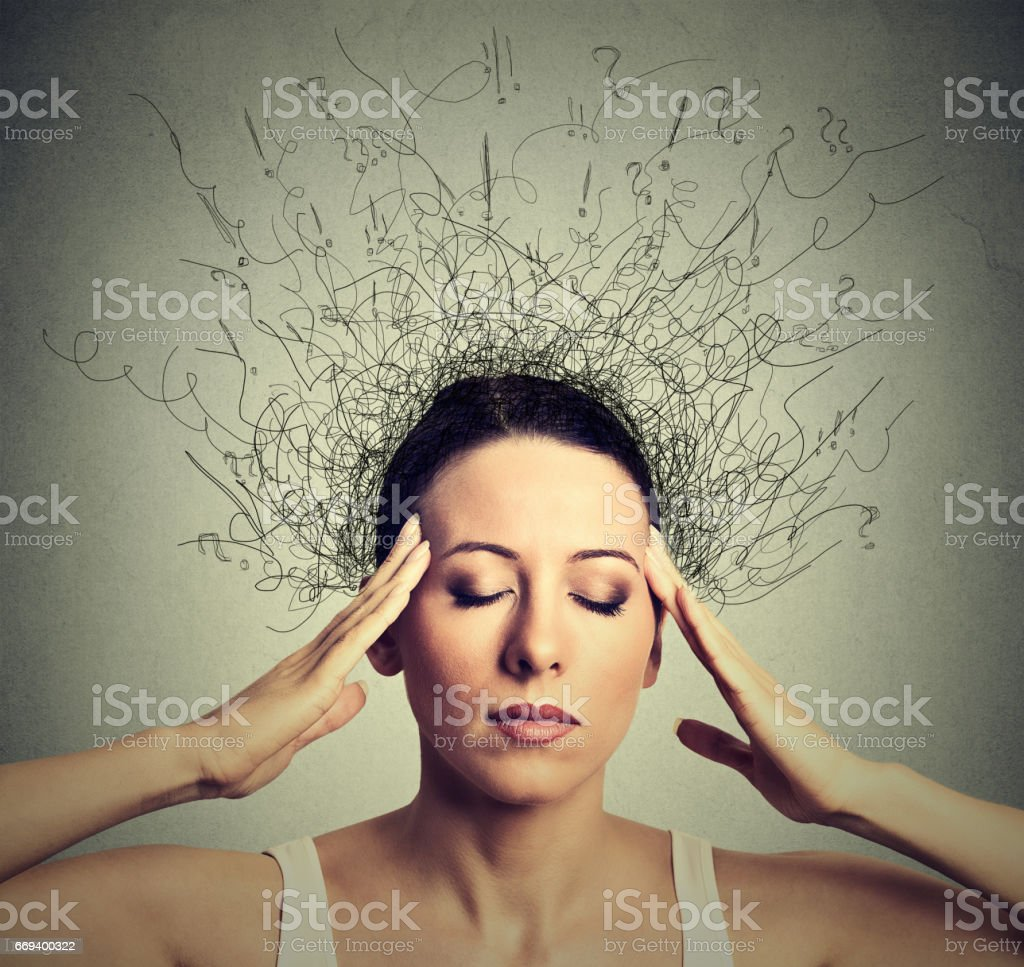 Closeup young woman with worried stressed face expression eyes closed trying to concentrate stock photo