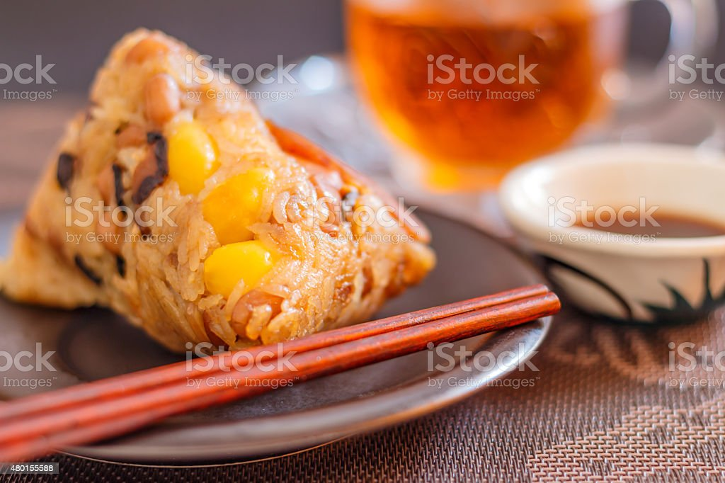 Closeup zongzi or sticky rice dumpling with tea. stock photo