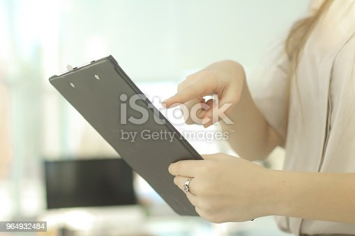 istock closeup.business woman reviewing the conditions of the contract. 964932484