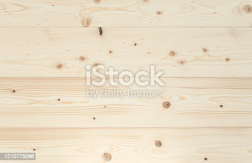 Close-up of a polished spruce board. Full frame background, photographed from above. You can use it for graphic design, pin board or furniture surface.