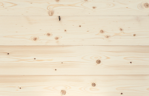 Close-upofapolishedspruceboard. Full frame background, photographed from above. You can use it for graphic design, pin board or furniture surface.