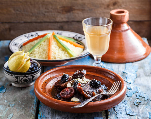 Closeview of tajine of beef with prunes and almonds. In tradiotional Moroccan dish. stock photo