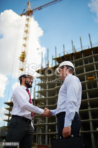 istock Closing a deal by shaking hands 516691324