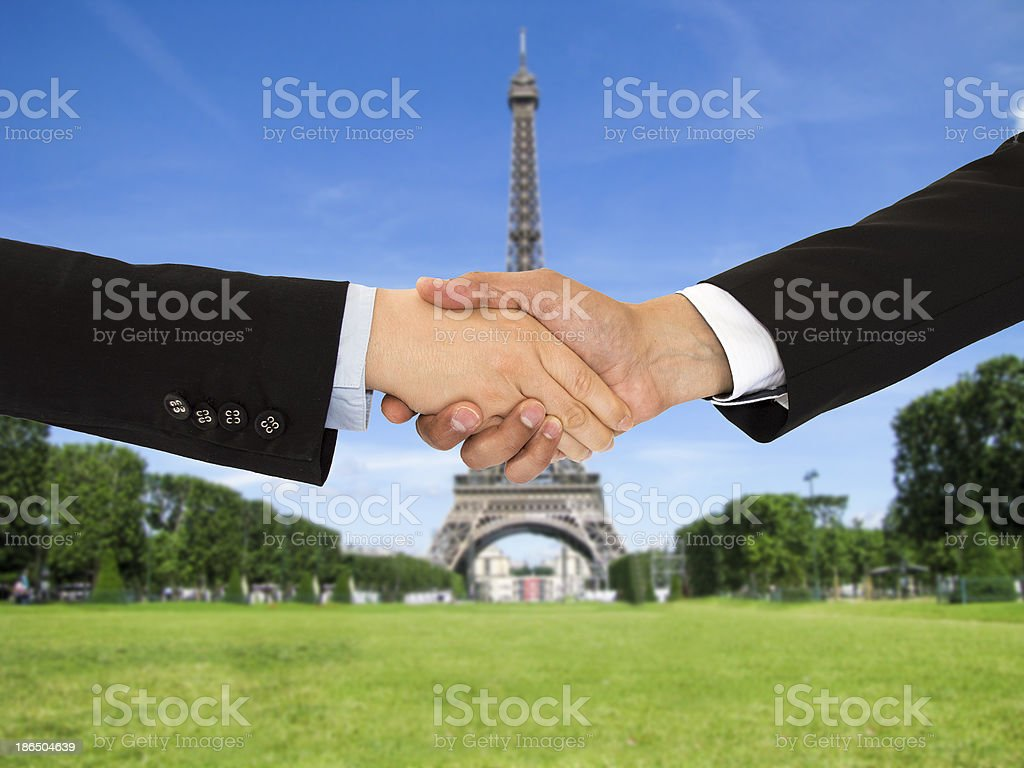 closing a deal in Paris royalty-free stock photo