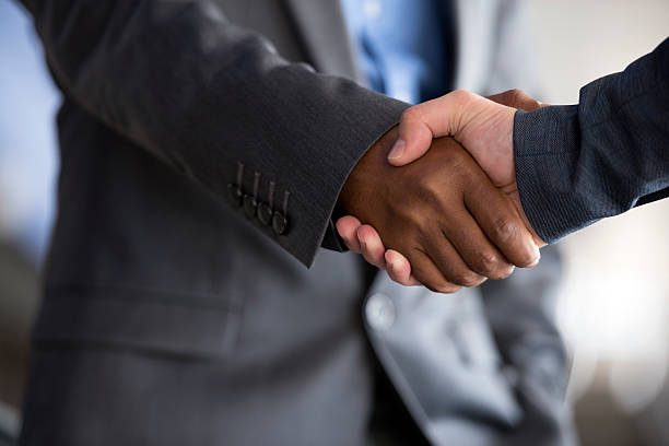 closing a deal. - gripping stock photos and pictures
