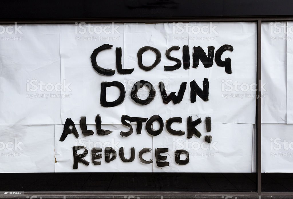 closing down all stock reduced Shop sign stock photo