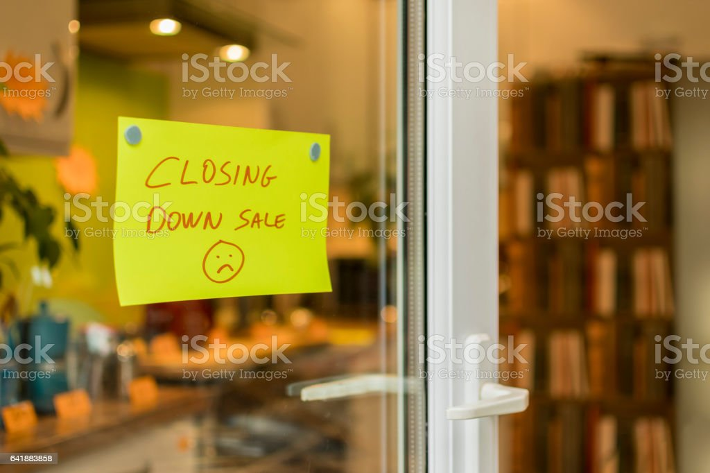 Closing Down Sale, sad face - shop sign stock photo