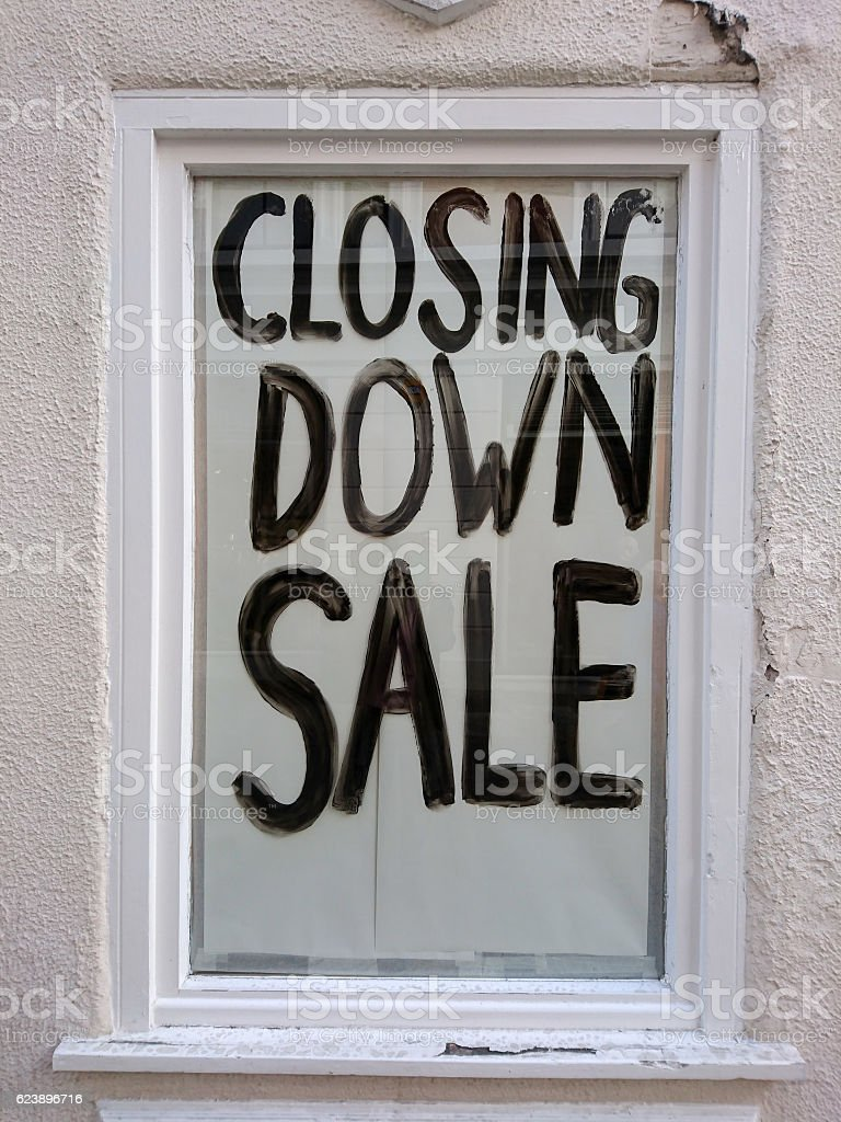 'Closing Down Sale' sign in a window. stock photo