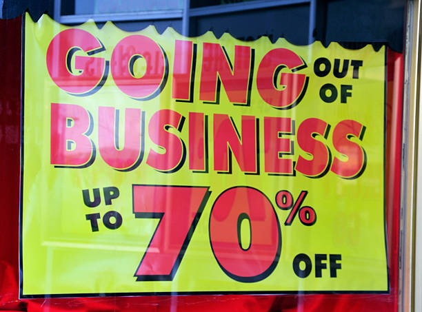 Closing down sales, for going out of business, up to 70% off stock photo