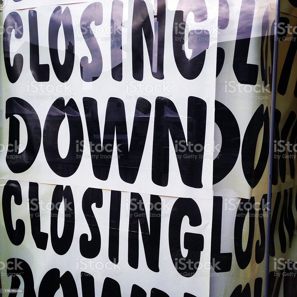 Closing down sign in window royalty-free stock photo