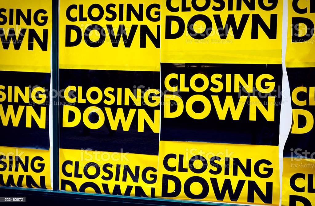 Closing down signs in a shop window stock photo
