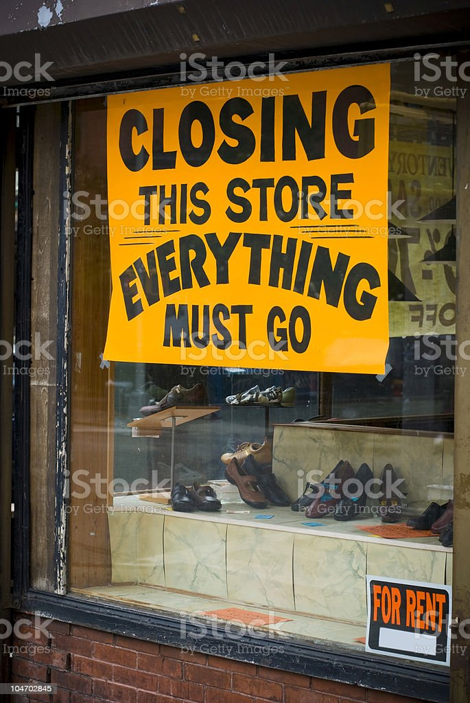 Closing down store sign in yellow stock photo