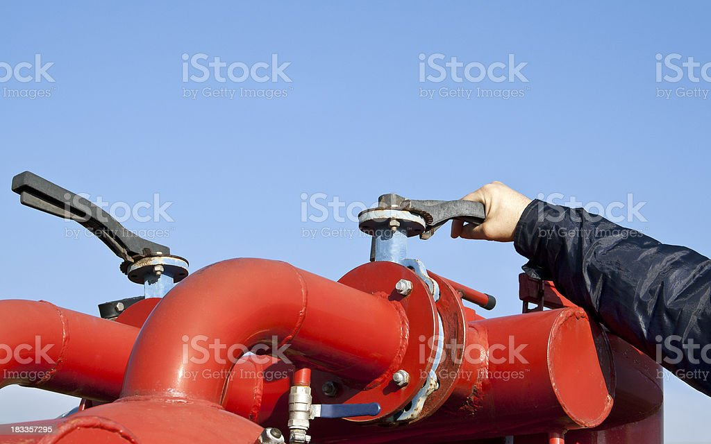 Closing or opening the valve stock photo