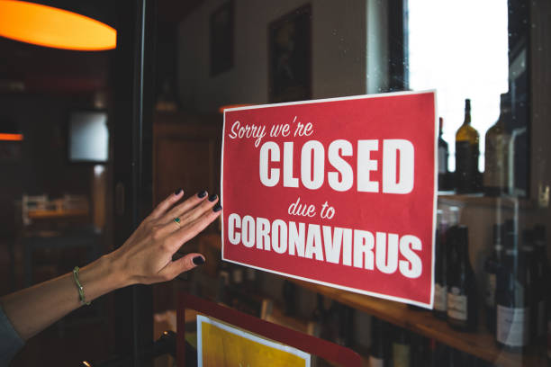 Closing sign applied to a door of a restaurant stock photo